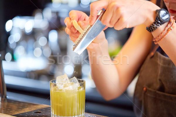 bartender grates chocolate to cocktail at bar Stock photo © dolgachov
