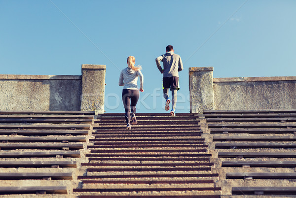 couple running upstairs on stadium Stock photo © dolgachov