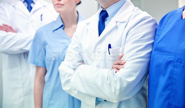 close up of medics or doctors at hospital corridor Stock photo © dolgachov