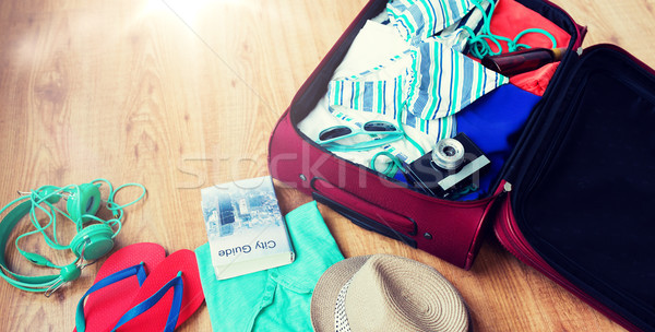 close up of travel bag with clothes and stuff Stock photo © dolgachov