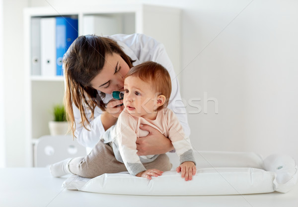 doctor with otoscope checking baby ear at clinic Stock photo © dolgachov