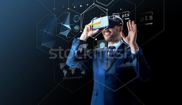 businessman in virtual reality headset over black Stock photo © dolgachov