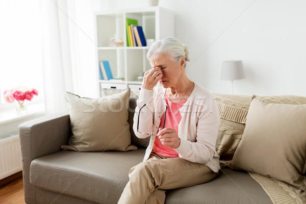 Senior mulher óculos dor de cabeça casa Foto stock © dolgachov