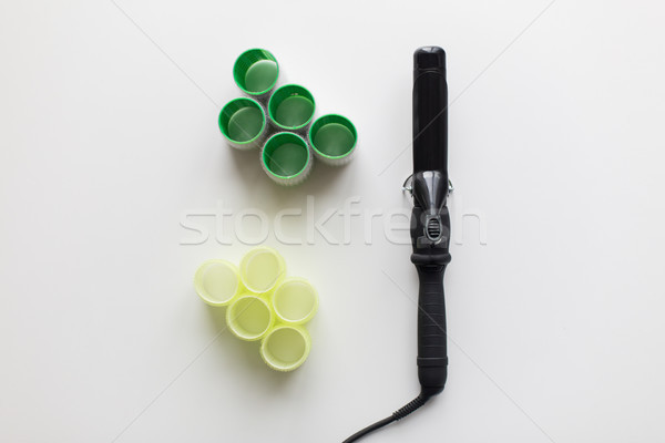 curling iron or hot styler and hair curlers Stock photo © dolgachov