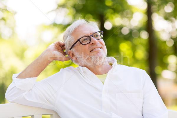 счастливым старший человека очки сидят лет Сток-фото © dolgachov