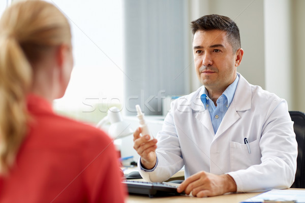 doctor with nasal spray and patient at hospital Stock photo © dolgachov
