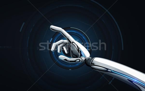 robot hand over black background Stock photo © dolgachov