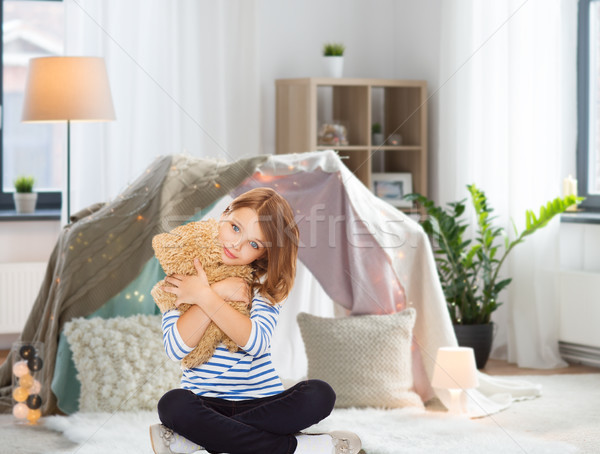 cute little girl hugging teddy bear at home Stock photo © dolgachov