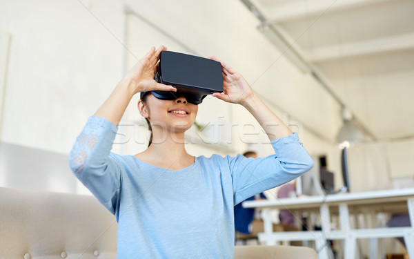happy woman with virtual reality headset at office Stock photo © dolgachov