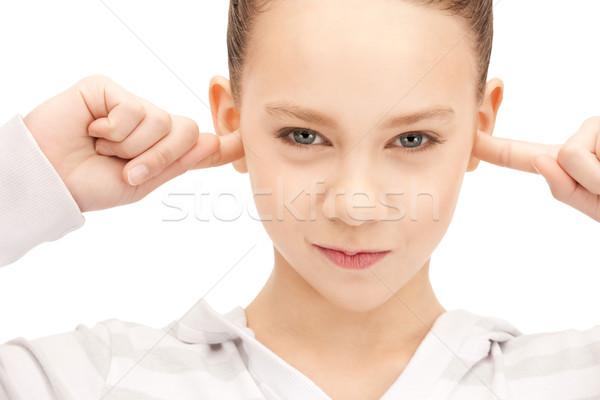 teenage girl with fingers in ears Stock photo © dolgachov