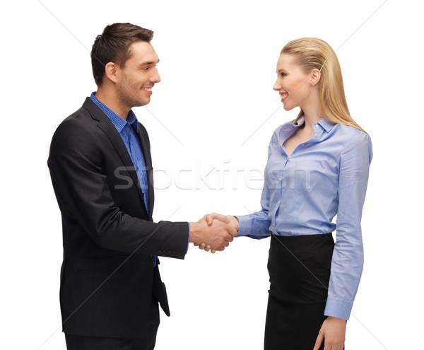 человека женщину рукопожатием ярко фотография бизнеса Сток-фото © dolgachov
