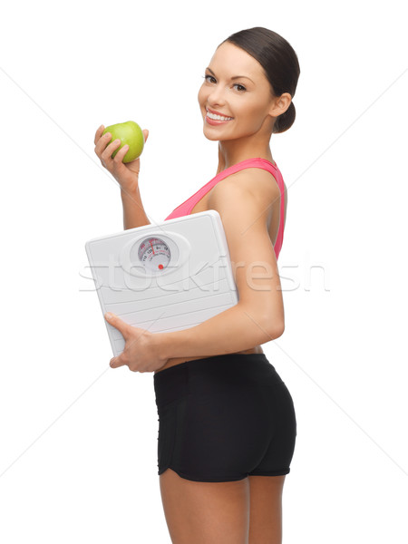 woman with apple and weight scale Stock photo © dolgachov