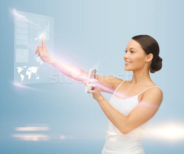 Kadın sanal ekran çalışma Stok fotoğraf © dolgachov