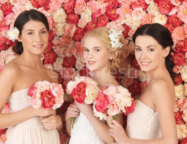 Három nők tele rózsák gyönyörű nő Stock fotó © dolgachov