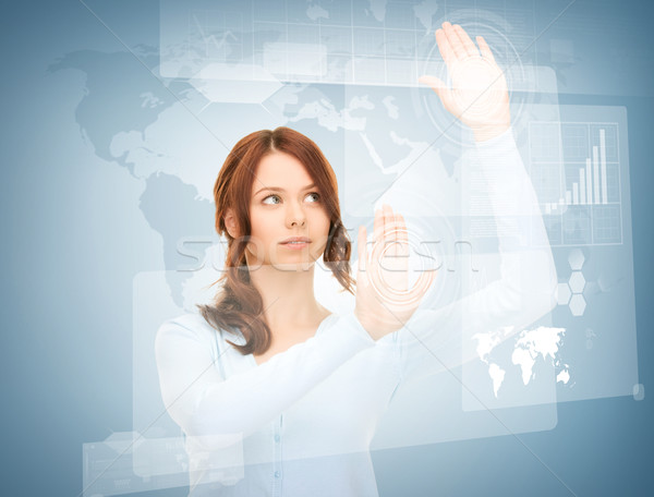 Stock photo: businesswoman touching virtual screen