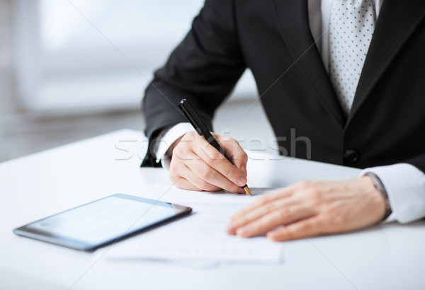 man with tablet pc signing paper Stock photo © dolgachov