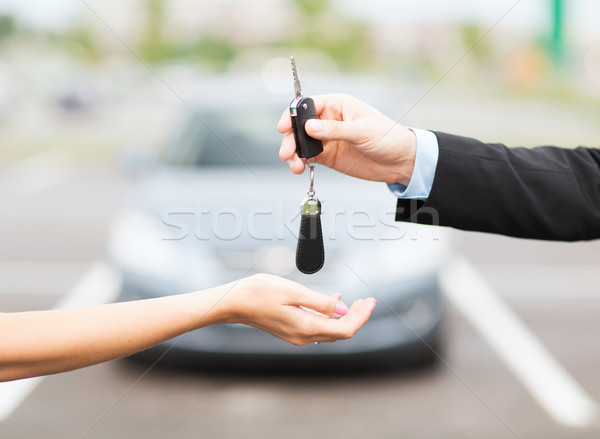 customer and salesman with car key Stock photo © dolgachov