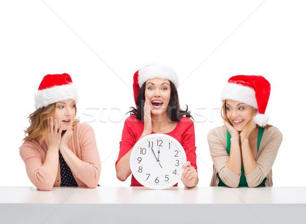 Mulheres ajudante relógio Foto stock © dolgachov