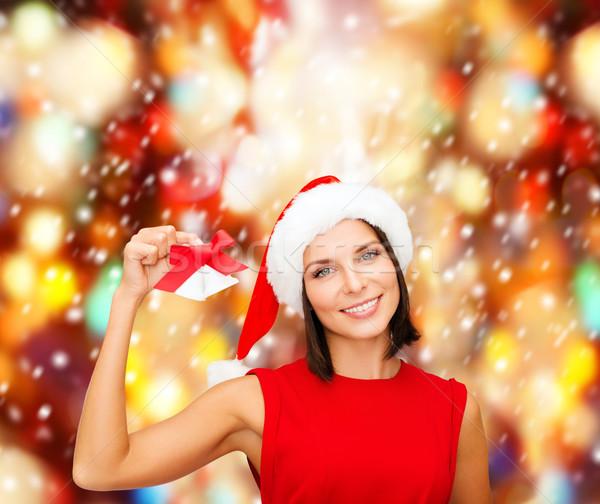 woman in santa helper hat with jingle bells Stock photo © dolgachov