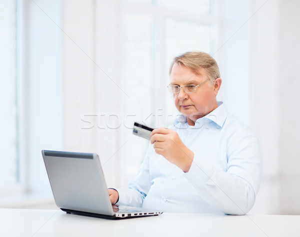 old man with laptop and credit card at home Stock photo © dolgachov