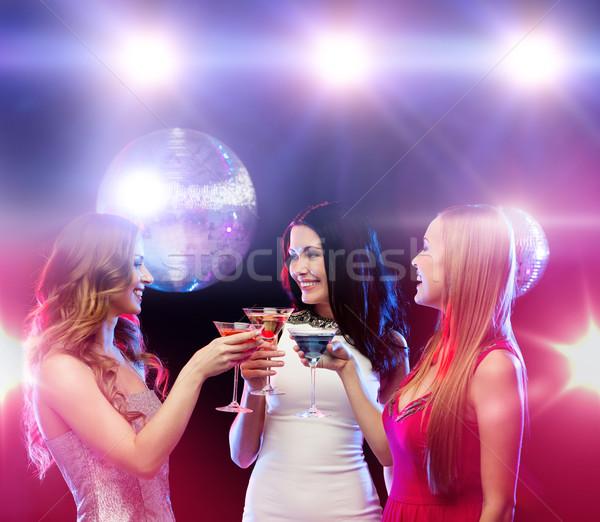 üç gülen kadın kokteyller disko topu yılbaşı Stok fotoğraf © dolgachov