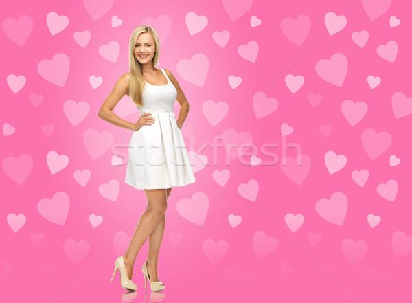 Kobieta biała sukienka różowy piękna moda walentynki Zdjęcia stock © dolgachov