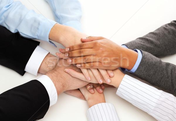 group of businesspeople celebrating victory Stock photo © dolgachov