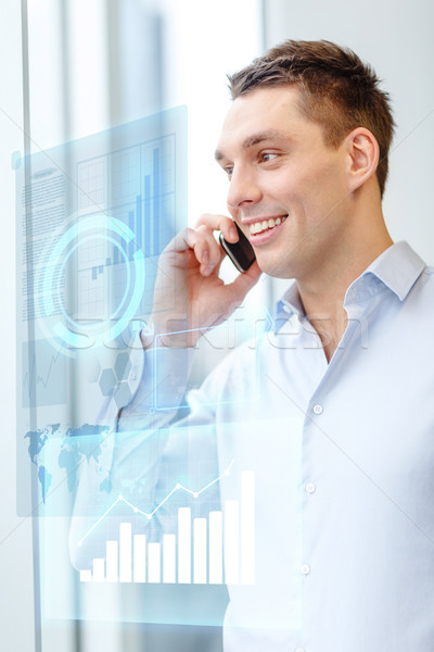 smiling businessman with smartphone in office Stock photo © dolgachov
