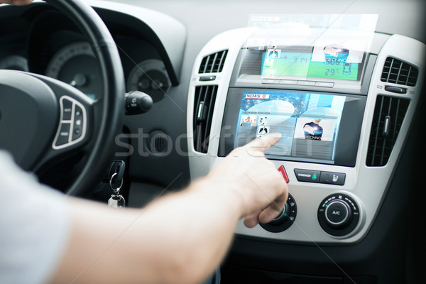 man using car control panel to read news Stock photo © dolgachov