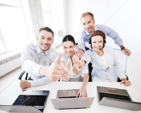 group of office workers showing thumbs up Stock photo © dolgachov