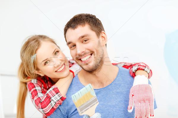 笑みを浮かべて カップル カバー 塗料 ペイントブラシ 修復 ストックフォト © dolgachov