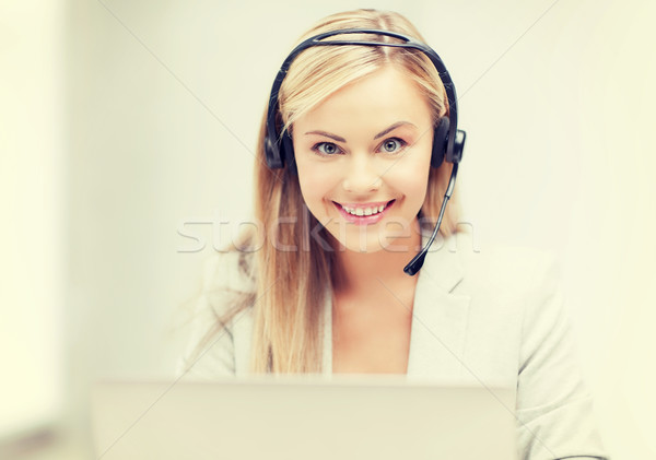 friendly female helpline operator with laptop Stock photo © dolgachov