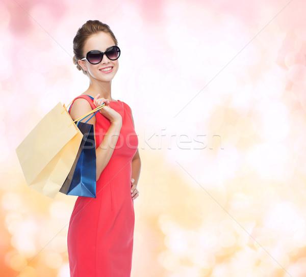 笑みを浮かべて エレガントな 女性 ドレス ショッピングバッグ ショッピング ストックフォト © dolgachov
