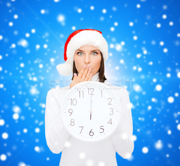 woman in santa helper hat with clock showing 12 Stock photo © dolgachov