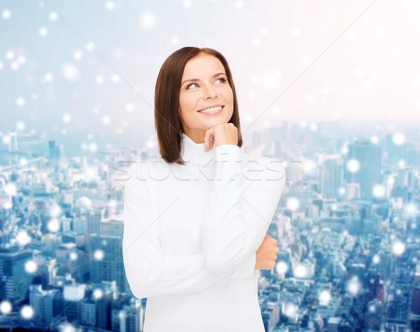 Glimlachend jonge vrouw winter kleding kleding vakantie Stockfoto © dolgachov