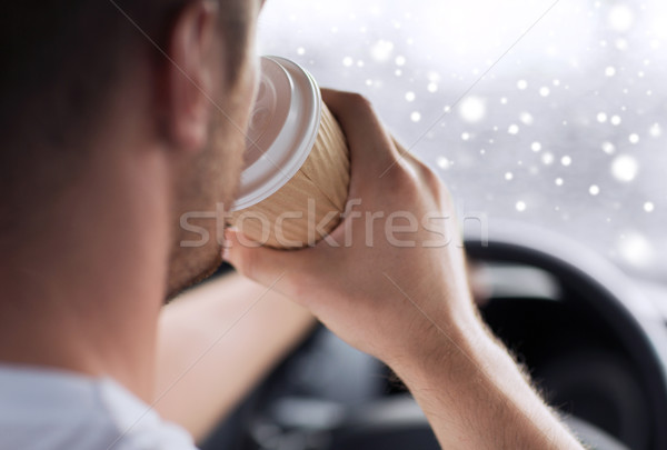 close up of man drinking coffee while driving car Stock photo © dolgachov