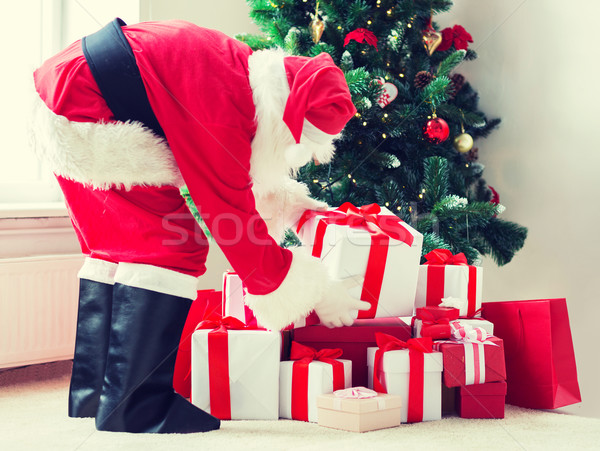 man in costume of santa claus with presents Stock photo © dolgachov