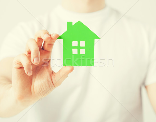 hand holding green house Stock photo © dolgachov