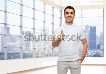 smiling man in t-shirt pointing fingers on himself Stock photo © dolgachov
