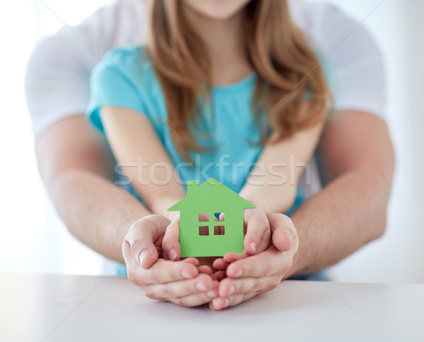 close up of man and girl hands with paper house Stock photo © dolgachov
