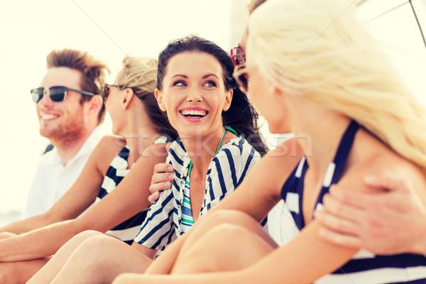 笑みを浮かべて 友達 座って ヨット デッキ 休暇 ストックフォト © dolgachov