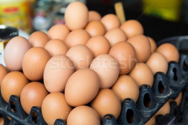 fresh eggs on tray at asian street market Stock photo © dolgachov