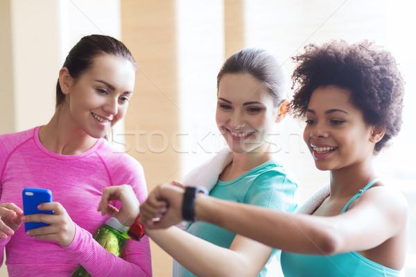 счастливым женщины время спортзал Сток-фото © dolgachov