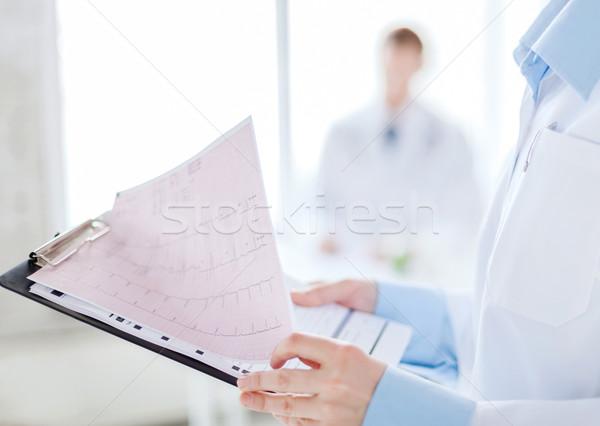 female holding clipboard with cardiogram Stock photo © dolgachov