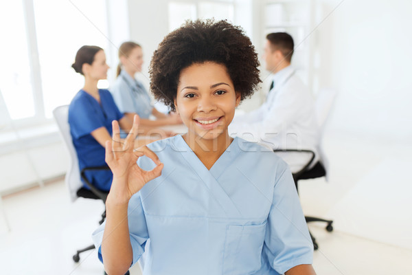 doctor or nurse showing ok hand sign at hospital Stock photo © dolgachov
