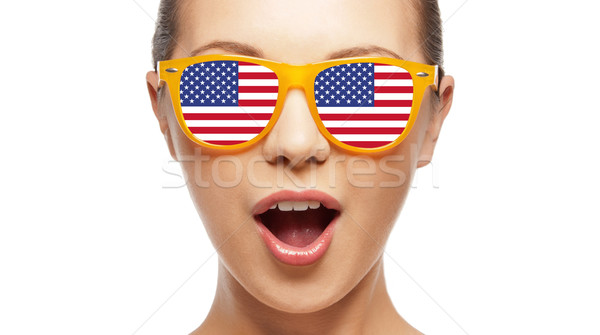 surprised girl in sunglasses with american flag Stock photo © dolgachov