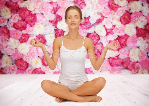 Kadın meditasyon yoga lotus poz insanlar Stok fotoğraf © dolgachov