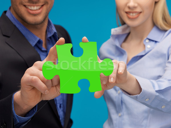 man and woman hands with green puzzle Stock photo © dolgachov