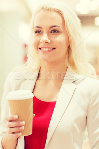 happy young woman with coffee paper cup in mall Stock photo © dolgachov