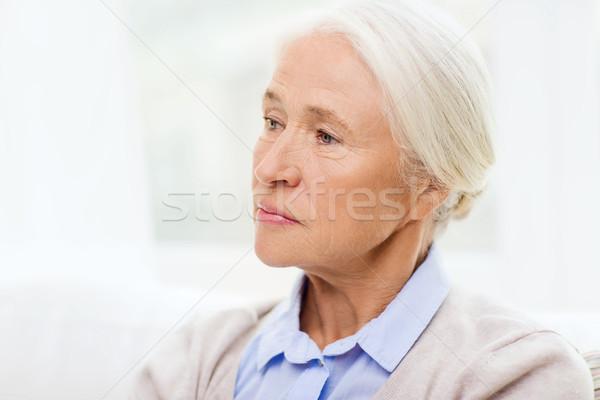 senior woman face at home Stock photo © dolgachov